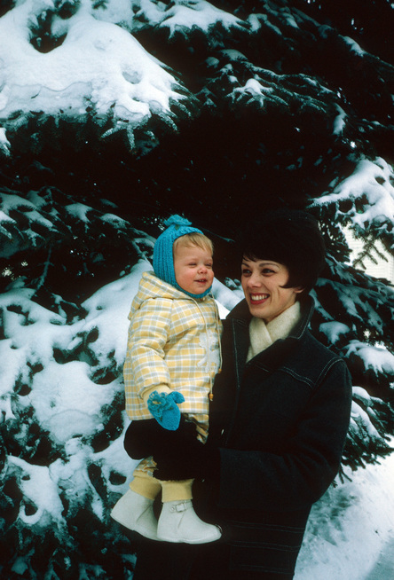 1969 Mom Holding Laura in the Snow